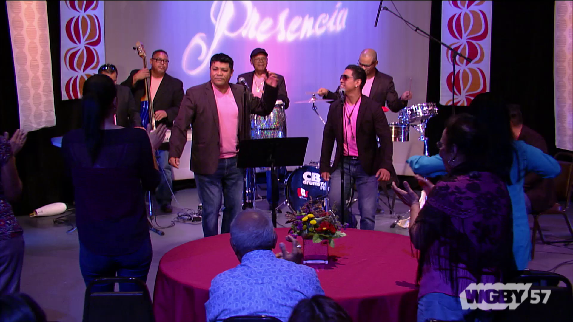 "Led by Bernando Orejuela and 11 other artists/musicians, Grupo Sabor Latino is a Peruvian musical band. Here the group performs ""Que Linda Flor."""