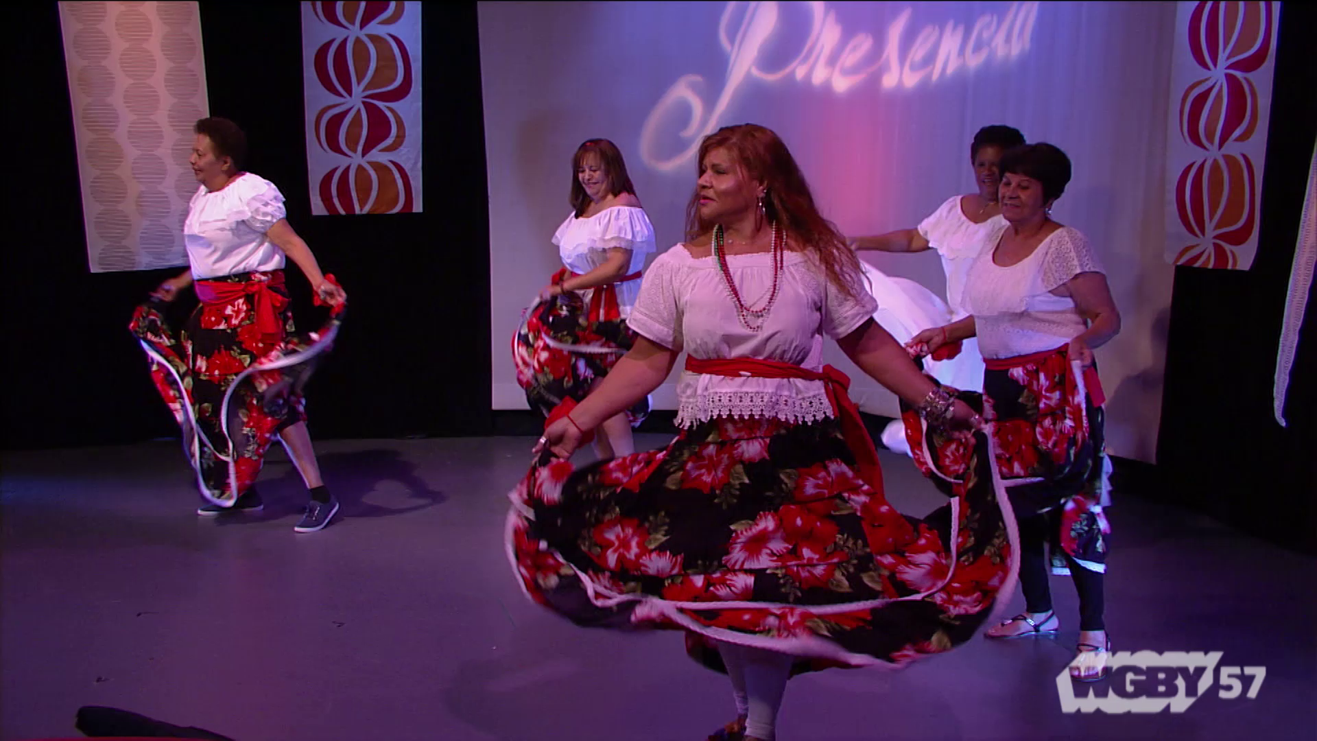 "Amapolas is a group of Bomba and Plena dancers, 55 years of age and older, from Holyoke Senior Center Here, they dance to the song,""El Conde de Loiza."""